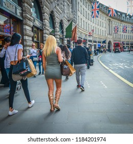 LONDON- MAY, 2018: Two female shoppers walking on Regent Street, a famous London landmark and popular shopping destination.