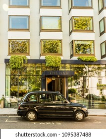 London. May 2018. A view of a black taxi, outside the hari Hotel, on Chesham Place, in Belgravia.