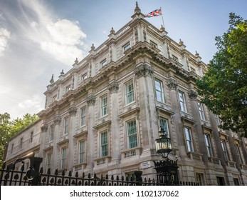 LONDON- MAY, 2018: View of Downing Street from Whitehall iron gates entrance showing the Cabinet Office and Department For Exiting the EU building.