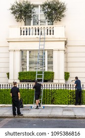 London. May 2018. A view of workmen cleaning the outside of an affluent house,on lyall street,  in belgravia, London.