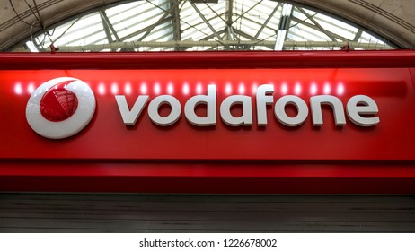 LONDON - MAY, 2018: Vodafone logo on a store. Vodafone UK is a provider of telecommunications services in the UK, and a part of the Vodafone Group, the world's second-largest mobile phone company.