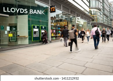 LONDON- MAY, 2019: A LLoyds bank branch on Victoria Street with people in motion blur, a British high street bank
