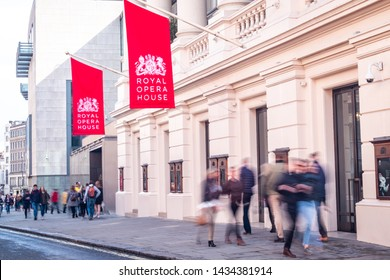 LONDON- MAY, 2019: Royal Opera House exterior and motion blurred people- a famous ballet and opera venue in the Covent Garden area of London's West End