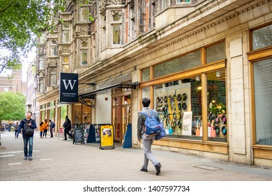 LONDON- MAY, 2019: Student walking past Waterstones bookshop next to the University College London campus in Bloomsbury