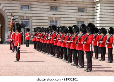 LONDON - MAY 21: British Royal guards perform the Changing of the Guard in Buckingham Palace on May 21, 2010 in London, UK