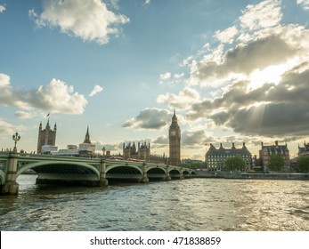 LONDON - MAY 24: Big Ben, the famous beautiful giant clock tower in London, England, with surrounding historic buildings along River Thames, and sunlight ray with cloudy sky, on May 24, 2016.
