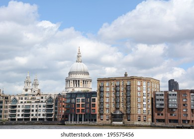 LONDON - MAY 25, 2014: St Paul's Cathedral and other architecture along the north bank of the Thames on May 25, 2014. Apartments and the Samuel Pepys bar line the riverbank.