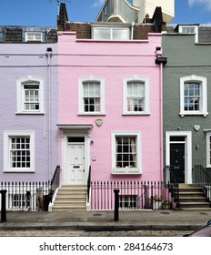 LONDON - MAY 26, 2015. A pink painted facade in a terrace of small eighteenth century English Georgian period town houses at Bywater Street in the Royal Borough of Kensington and Chelsea, London, UK