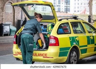 LONDON, MAY 26, 2016: Female Ambulance Paramedic, Rapid Response Vehicle.
