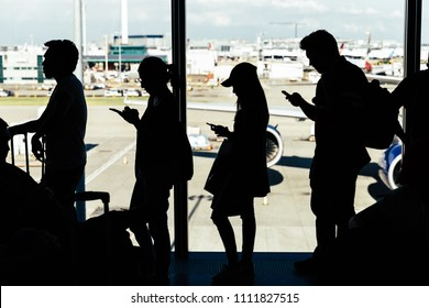 LONDON - MAY 27, 2018: People by windows waiting to board plane at London Heathrow airport