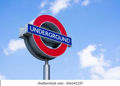London, May 27th 2017 - London Underground sign against a blue sky background - copy space provided.