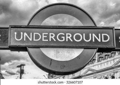 LONDON - MAY 28: Subway sign in London, May 28, 2015. The London Subway system serves 270 stations and has 402 kilometres (250 mi) of track.