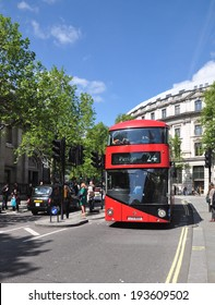 LONDON -�� MAY 3. A London  Routemaster diesel-electric hybrid double deck bus with three doorways and two staircases accommodates 80 passengers; May 3, 2014, in St Martin's Place, London, UK.
