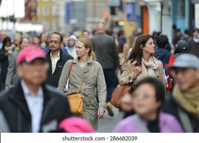 LONDON - MAY 30: People walk along a busy shopping street in Chinatown on May 30, 2015 in London, UK. Over 120,000 people of Chinese ethnicity live in London, 33% of the UK's Chinese population.
