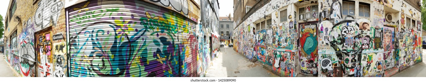 LONDON - MAY 30: Street view of Brick Lane, place of London's best street art on May 30, 2019 in London, UK. Brick Lane and Shoreditch area, East London, is the heart of Bangladeshi community.