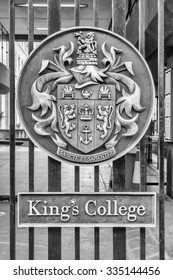 LONDON - MAY 31: Emblem on the entrance gate of King's College in London, May 31, 2015. King's College is regarded as one of the leading multidisciplinary research universities in the world