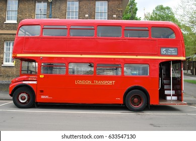LONDON - MAY 4: Routemaster Bus operating in London on MAY 4, 2017 in London, UK. The open platform facilitated speedy boarding under the supervision of a conductor.