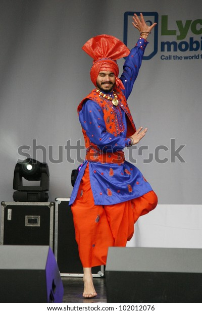 LONDON - MAY 6: Performers take part in the festival of Vaisakhi, celebrating the birth of Sikhs, celebrated across northern India especially Punjab region on May 6, 2012, Trafalgar Square, London, UK