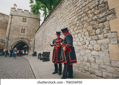 LONDON - MAY 9 2017: Beefeater guards or Yeoman warders at the Tower of London. In principle they are responsible for looking after any prisoners in the Tower and safeguarding the British crown jewels