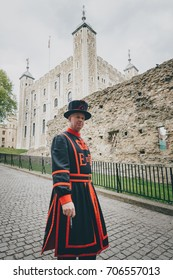LONDON - MAY 9 2017: Beefeater guard or Yeoman warder at the Tower of London. In principle they are responsible for looking after any prisoners in the Tower and safeguarding the British crown jewels