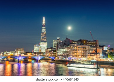 London night cityscape around Southwark, on the south bank of the River Thames near Tower Bridge.