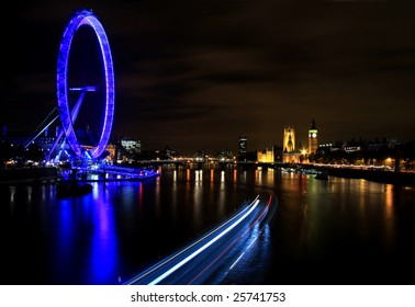 London at Night with Millennium Wheel, River Thames and Boats