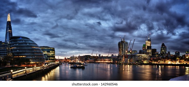 London at night , panoramic view from river.