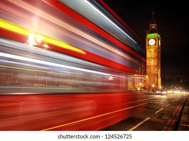 London night scene of Westminster and Big Ben with famous London bus driving by