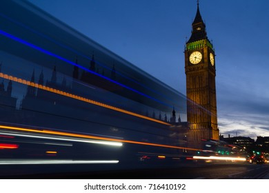 London night view across Big Ben with traffic passing through