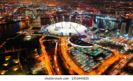 London, North Greenwich / United Kingdom: March 15 2019: Aerial night shot from iconic O2 Arena in Greenwich Peninsula