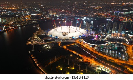 London, North Greenwich / United Kingdom: March 18 2019: Aerial night shot from iconic O2 Arena in Greenwich Peninsula