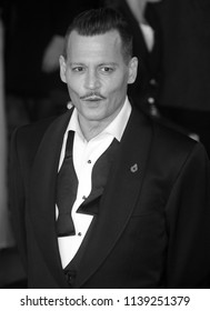 LONDON - NOV 02, 2017: ( Image digitally altered to monochrome ) Johnny Depp attends the Murder on the Orient Express film premiere