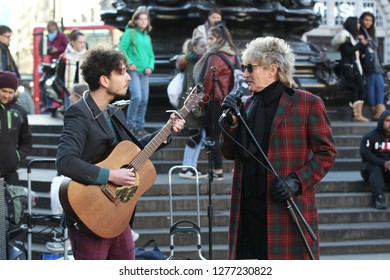 LONDON - NOV 06, 2017: Rod Stewart seen busking at Piccadilly Circus with fellow busker Henry Facey