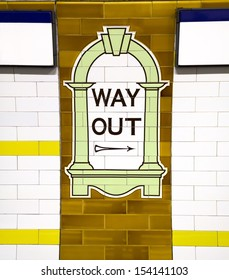 LONDON - NOV 15: Way Out sign, painted on the wall tiles in London Underground, November 15, 2012, England