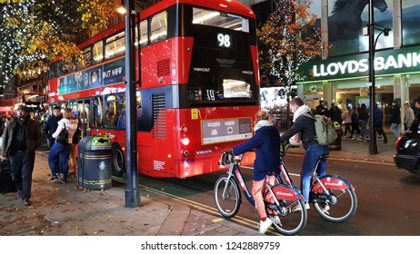 LONDON - NOV 17: Commuter's on rental bike on Nov 17, 2018 in London, UK. London's bicycle sharing scheme, launched with 6000 bikes, 400 docking stations on 2010 to help ease traffic congestion.
