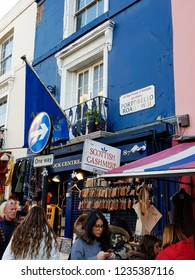 LONDON - NOV 17: Saturday view of Portobello Market, in Notting Hill district, largest antiques market in UK, famous tourist attractions, on Nov 17, 2018, London, UK. Market area is about 940 m long.