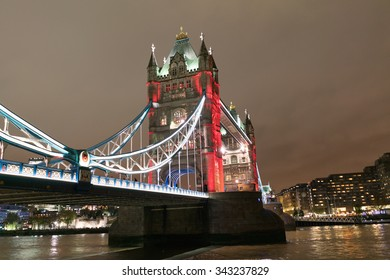 LONDON - NOV 5 : London Tower Bridge pictured at night on November 5th, 2015, in London, UK. Built in 1886, it is a combined bascule and suspension bridge in London over the River Thames.
