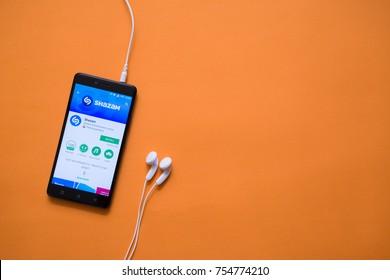 London, november 14, 2017: Shazam application in google play store on orange background