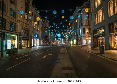 LONDON - NOVEMBER 19, 2016: Christmas lights on Oxford Street, London, UK. The full length of the busiest shopping area in central London is decorated with 1778 glowing white and golden orbs.