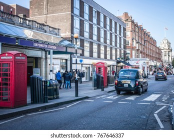 LONDON- NOVEMBER, 2017: Bayswater Tube Station on Queensway, a cosmopolitan street in West London with many shops and restaurants