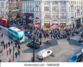 LONDON- NOVEMBER, 2017: Busy scene at Oxford Circus, a famous London landmark crossroads between Regent Street and Oxford Road famous for their shops.