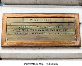 London, November 2017. A front external view of a sign outside the Odey Asset management offices on Grosvonor Square in Mayfair.