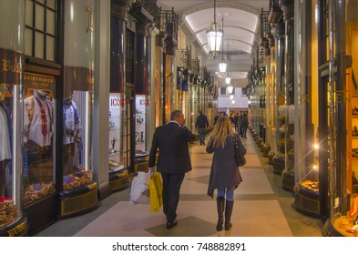 LONDON- NOVEMBER, 2017: Shoppers walk through the Piccadilly Arcade in Mayfair, an indoor gallery of high end fashion shops.