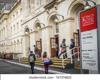 LONDON- NOVEMBER, 2017: Students at the entrance of Kings College London Kings Building on the Strand in London