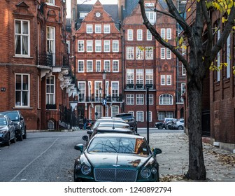 LONDON- NOVEMBER, 2018: An attractive street of grand red brick townhouses in Knightsbridge area of Westminster