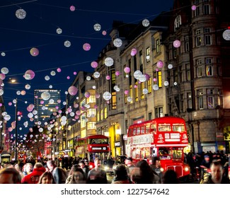 LONDON- NOVEMBER, 2018: Oxford Street night shopping scene with Christmas decorations, a world famous London landmark and retail destination