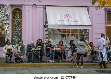 LONDON- NOVEMBER, 2018: Peggy Porschen bakery on Ebury Street in Belgravia. A famous boutique bakery selling fancy cakes, tea and champagne