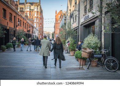 LONDON- NOVEMBER, 2018: People walking on Pavilion Street in Knightsbridge, an attractive street of shops and restaurants close to Sloane Street and Kings Road Chelsea