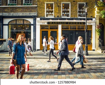 LONDON- NOVEMBER, 2018: Shoppers on high street in London's Covent Garden, an upmarket area of shops and restaurants