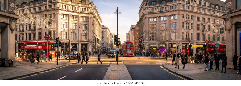 LONDON- NOVEMBER, 2019: Oxford Street / Oxford Circus wide angle panoramic view. A London land mark and famous shopping destination